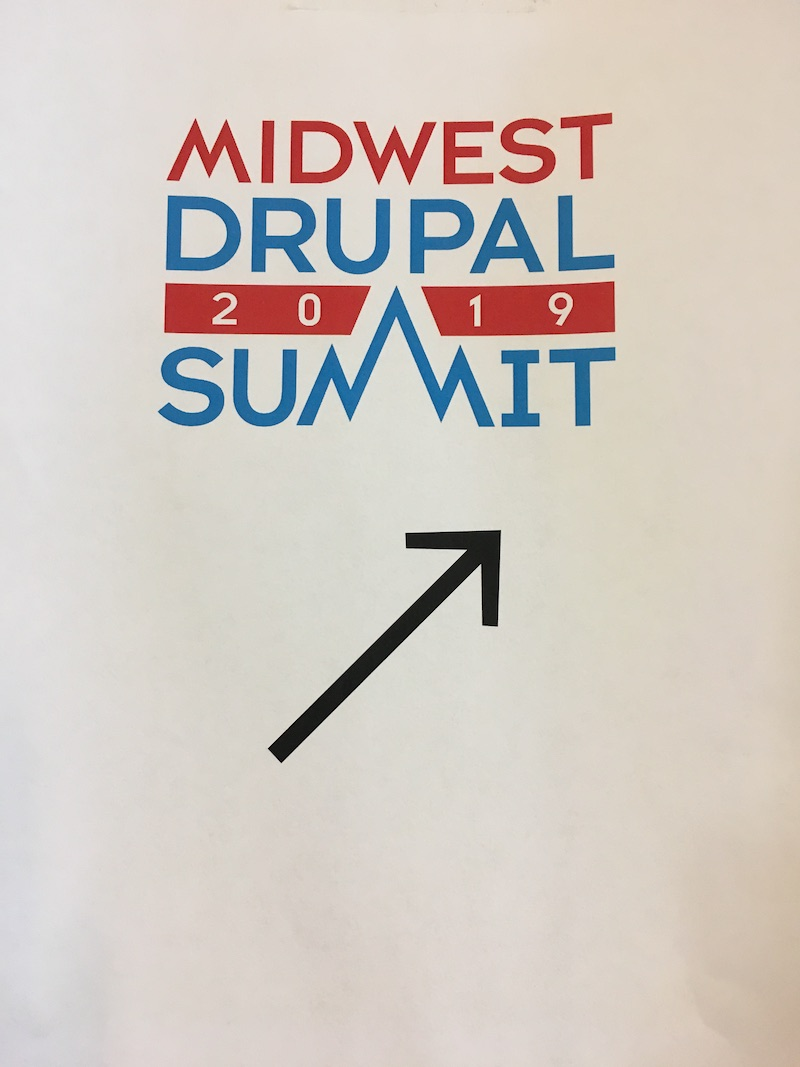 MWDS 2019 door sign with arrow pointing up to the right