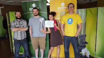 Cheeky Monkey team holding their certificate of membership in 2016