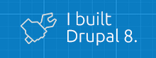 I built Drupal 8 with hand holding a wrench on blue background