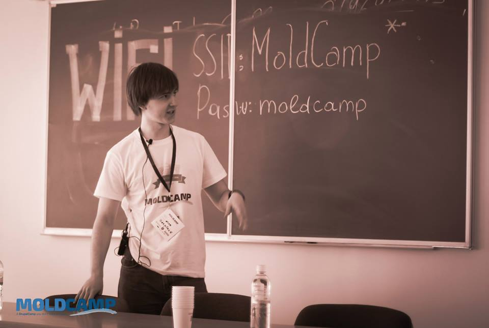 Mold Camp speaker at blackboard