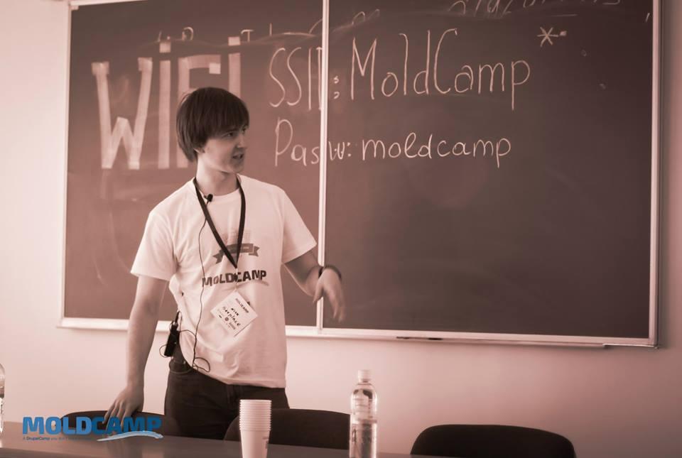 Mold Camp speaker at blackboard