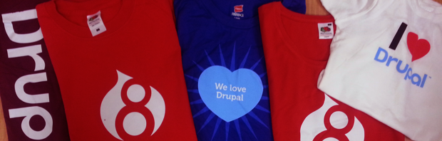 Assorted red and blue Drupal tee shirts